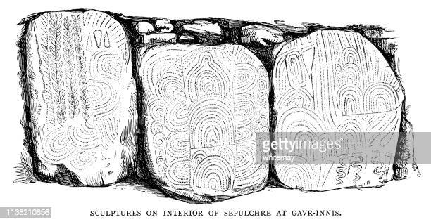 Decorated slabs in the Gavrinis passage tomb, France