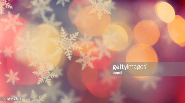 defocused lights and snowflakes - illuminated stock illustrations