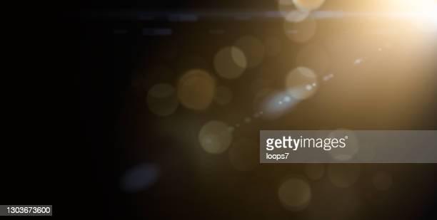 defokussierte lichter mit objektiv flare - glamour stock-grafiken, -clipart, -cartoons und -symbole