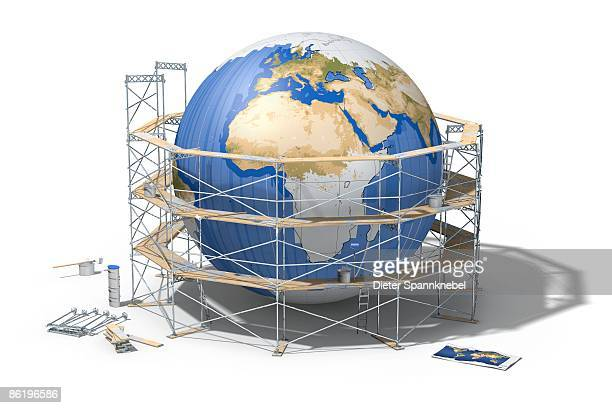 Depainted globe circled by a scaffolding