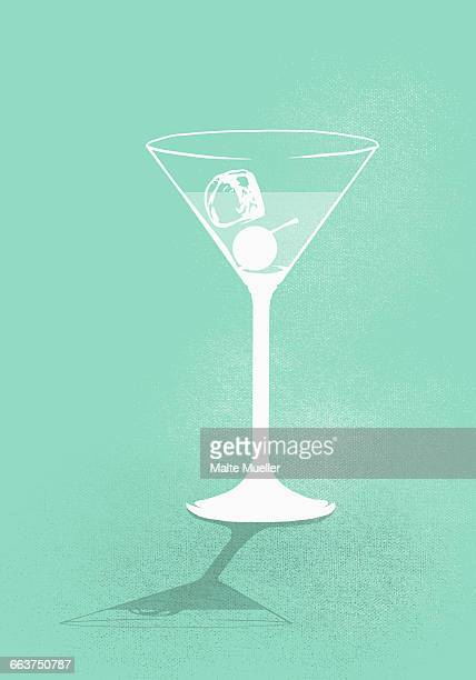 Digital composite image of cocktail against green background