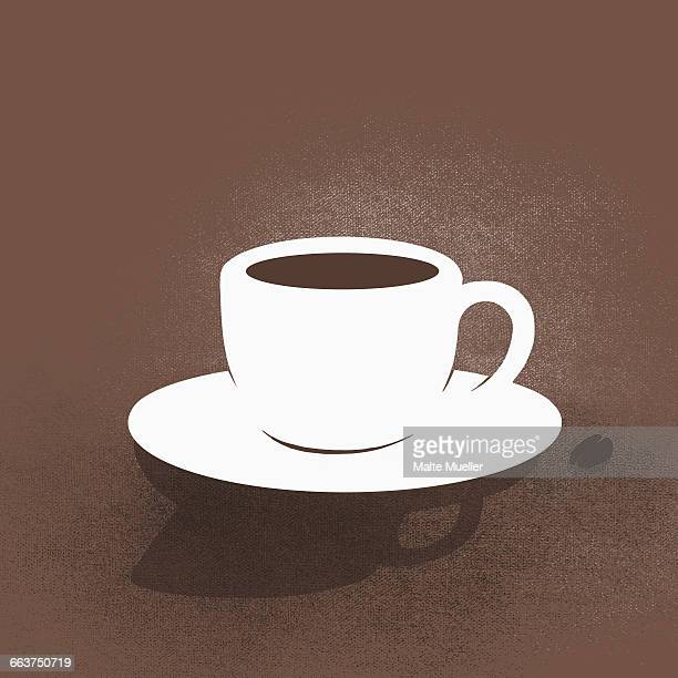 digital composite image of coffee cup with saucer against brown background - roasted coffee bean stock illustrations