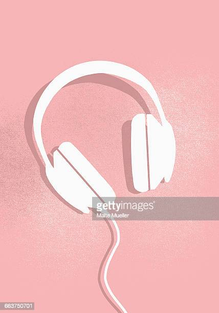 Digital composite image of headphones on pink background