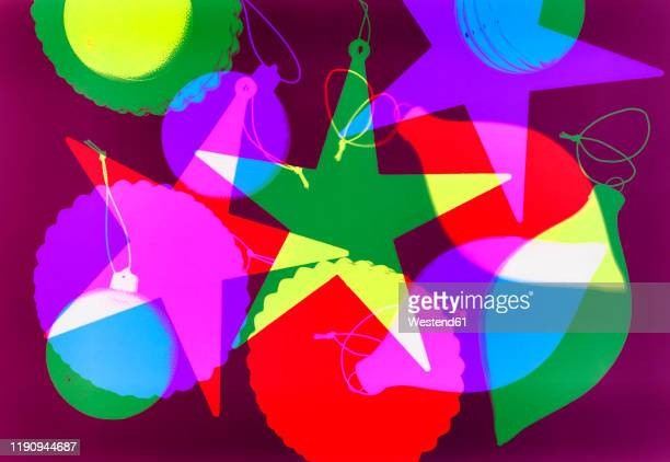 digitally generated image of various christmas decorations on magenta background - image technique stock illustrations