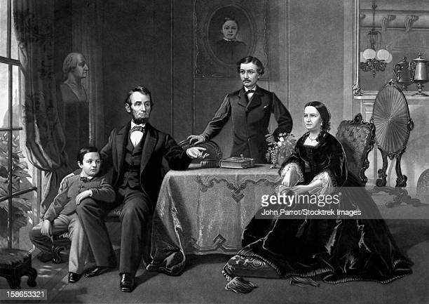 ilustraciones, imágenes clip art, dibujos animados e iconos de stock de digitally restored vintage print of president abraham lincoln and his family. lincoln's son thomas is seated on the left, his wife mary todd is seated at the table, and robert todd lincoln is standing. - president