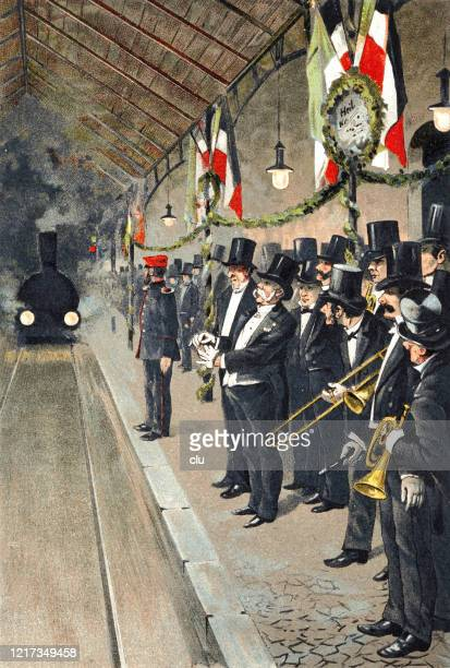 dignitaries and brass bands await the arrival of a state guest at the train station - royal person stock illustrations