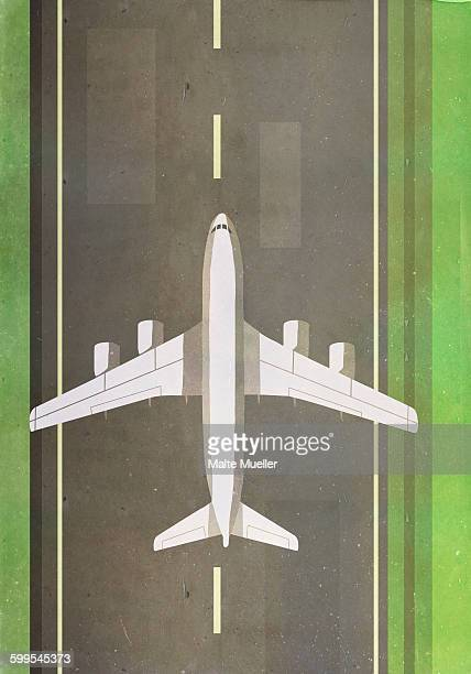 Directly above shot of airplane on runway