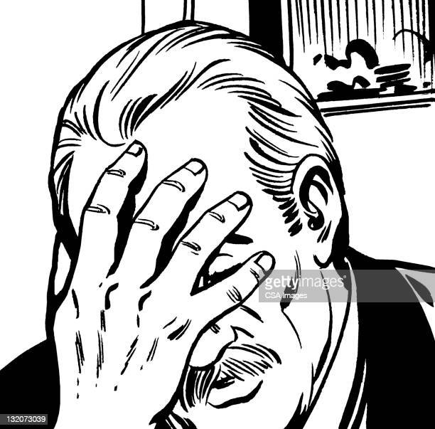 Distraught Man Covering Face With Hand