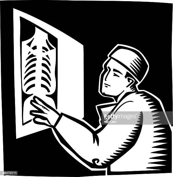 A doctor reading an x-ray