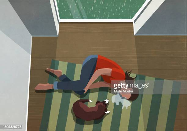 dog laying next to depressed woman crying on floor - grief stock illustrations