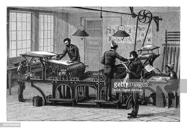Double printing press in workshop (antique engraving)
