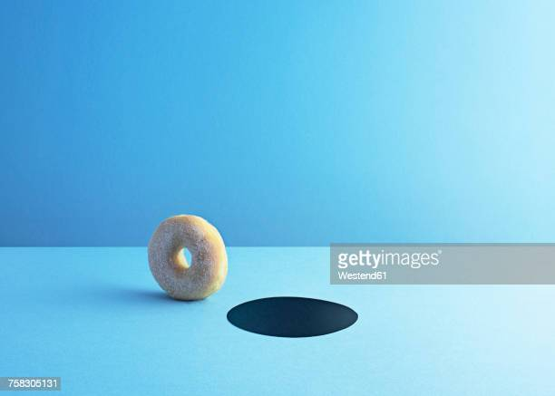 doughnut and hole on light blue ground - sugar food stock illustrations, clip art, cartoons, & icons