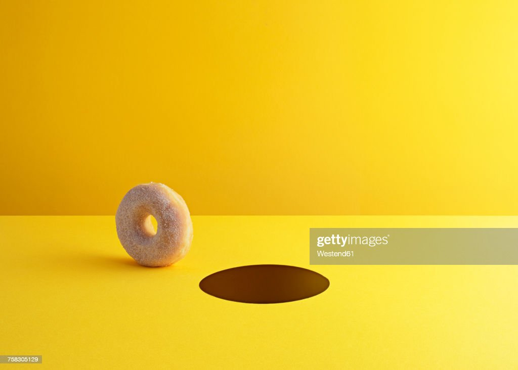 Doughnut and hole on yellow ground : stock illustration