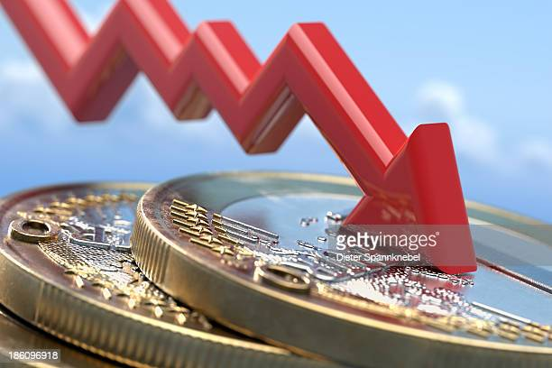 Down arrow on a stack of euro coins