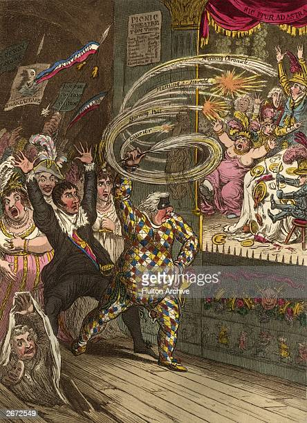 Dramatist Richard Brinsley Sheridan dressed as a harlequin leads the professionals against the amateurs of the PicNic society Following him are...
