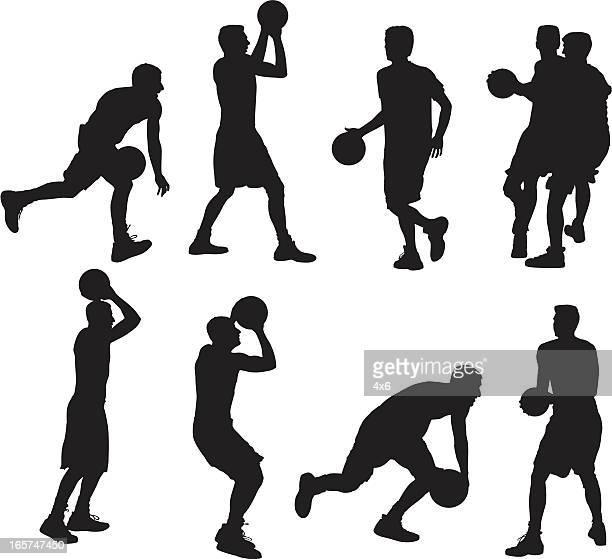 Dribbling and shooting basketball players