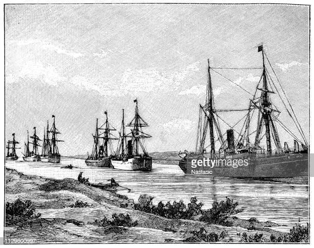 a drive through the suez canal - suez canal stock illustrations
