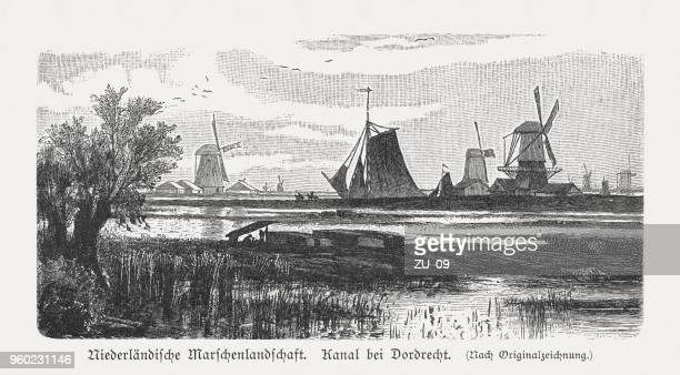 dutch marshland, channel near dordrecht, wood engraving, published in 1897 - dordrecht stock illustrations