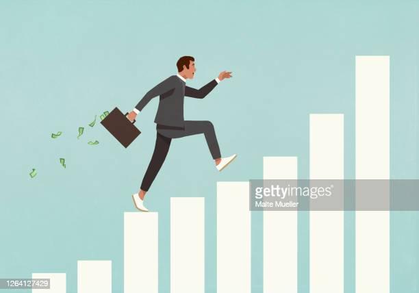 eager businessman with briefcase of money running up ascending bar graph - geld verdienen stock-grafiken, -clipart, -cartoons und -symbole