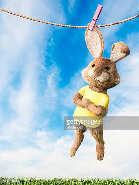 easter bunny hanging on clothes line with arms crossed - easter bunny costume stock illustrations, clip art, cartoons, & icons