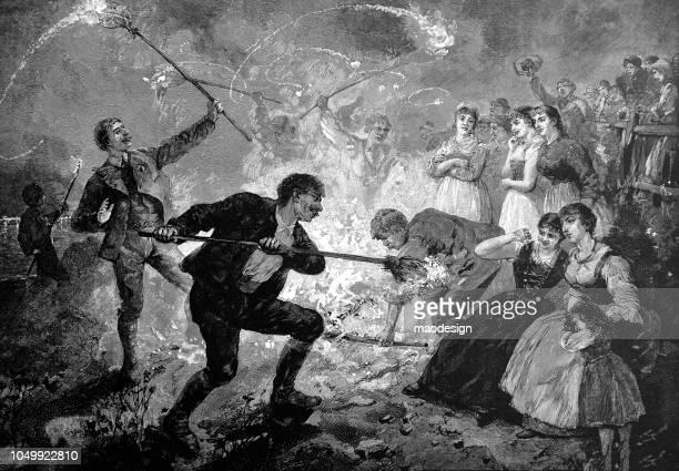 oster-party mit feuer und traditioneller tanz - 1888 - osterfeuer stock-grafiken, -clipart, -cartoons und -symbole