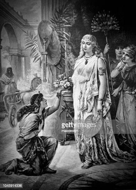 egyptian goddess gets a bouquet of flowers from a young egyptian girl - 1888 - north african ethnicity stock illustrations, clip art, cartoons, & icons