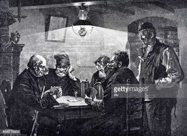 Elder men sitting in restaurant playing cards