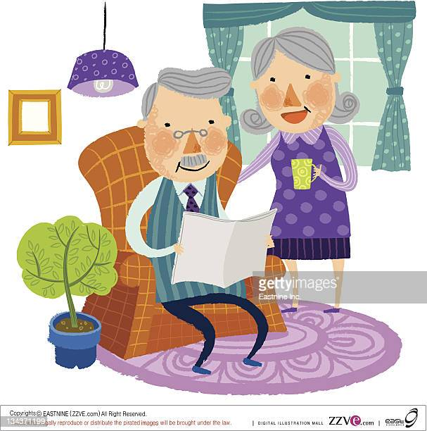Elderly couple reading newspaper