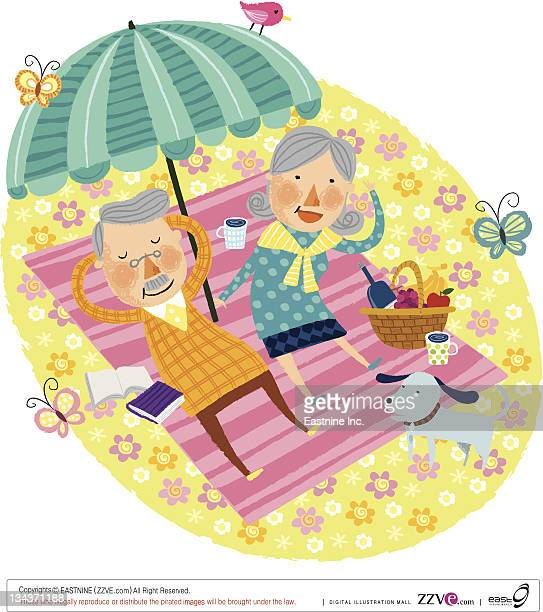 Elderly couple relaxing on beach