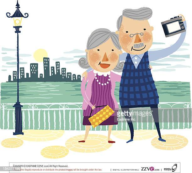 Elderly couple taking photo of themselves