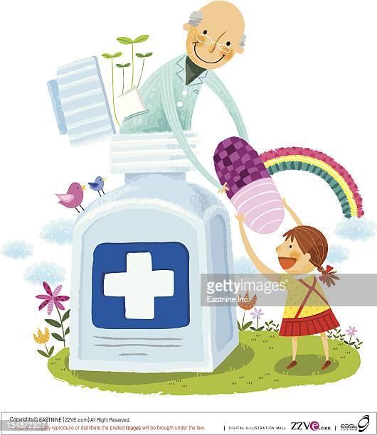 Elderly man giving girl child capsule from medicine bottle