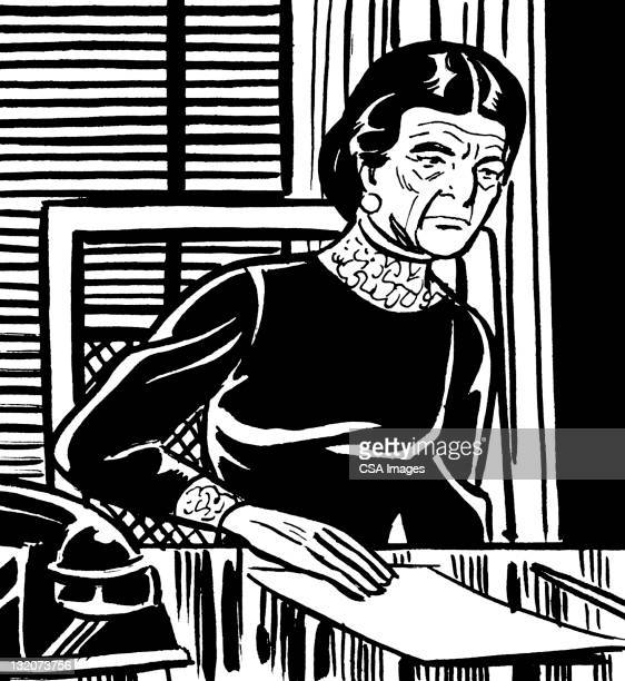Elderly Woman Sitting at Desk