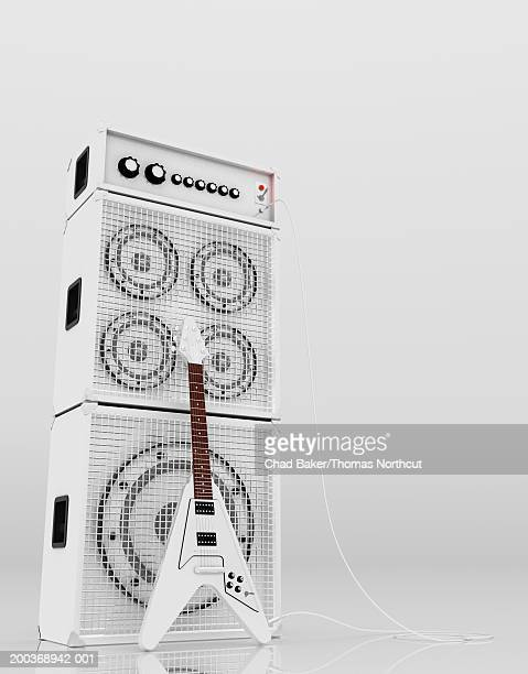 Electric guitar leaning against stack of amplifiers (Digital)