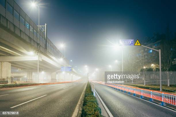 elevated road in the smog - traffic stock illustrations