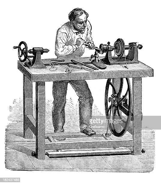 Engarving carpenter working at lathe