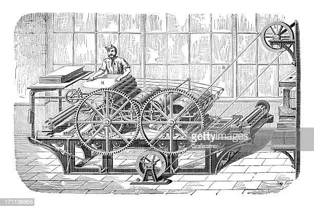engraving of man working at a printing machine - printing press stock illustrations