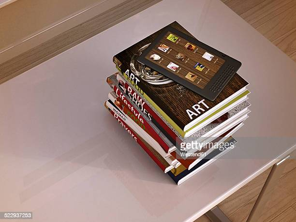 E-reader and stack of books lying on a table, 3D Rendering