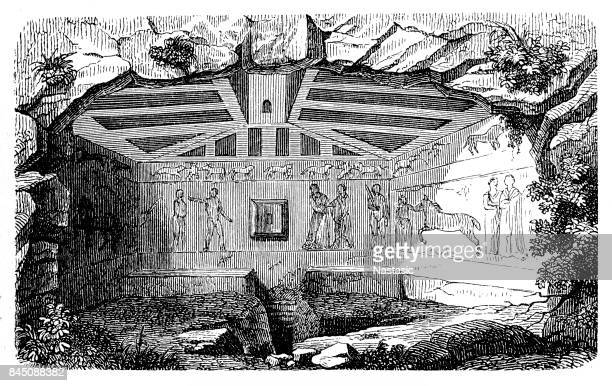 etruscan tombs in tarquinia - etruscan stock illustrations