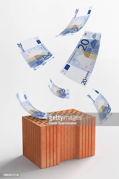 euro banknotes falling on a brick - european union euro note stock illustrations, clip art, cartoons, & icons