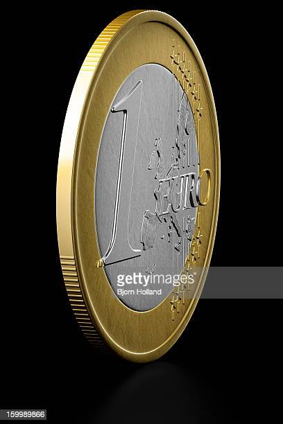 Euro Coin on black reflective background