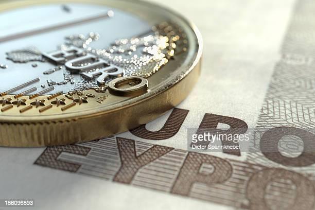 Euro coin on euro note
