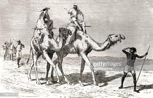 Europeans riding camel in African desert