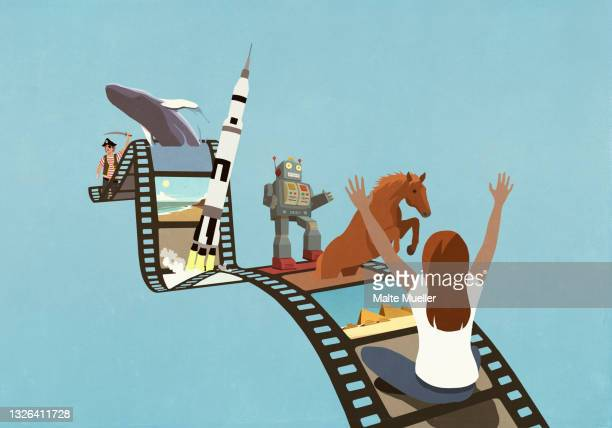 excited woman enjoying nature and science images on film reel - nostalgia stock illustrations