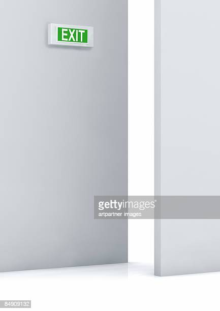 exit sign next to an open door - next stock illustrations