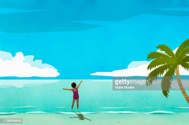 exuberant woman wading in sunny tropical ocean - horizontal stock illustrations
