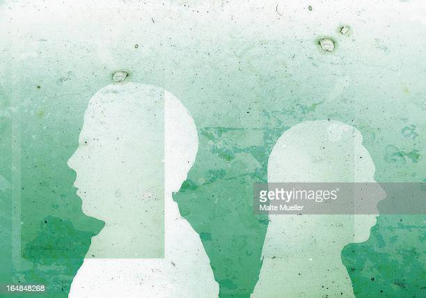 a faceless man with his back against the back of a faceless woman - communication problems stock illustrations