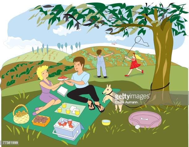 A family enjoying their picnic in the park