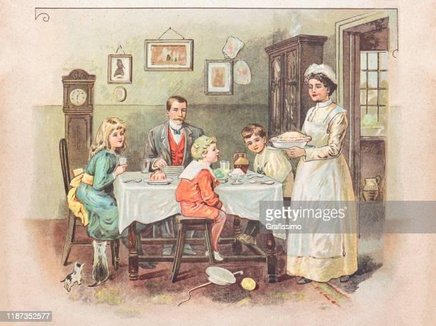 リビングルームで夕食を食べる家族 1900 - 1900~1909年点のイラスト素材/クリップアート素材/マンガ素材/アイコン素材