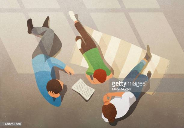 family relaxing, reading book - parent stock illustrations
