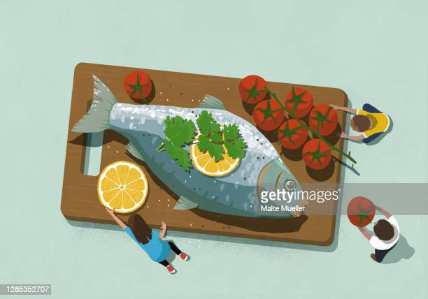 family sharing large fish dinner with tomatoes - scale stock illustrations